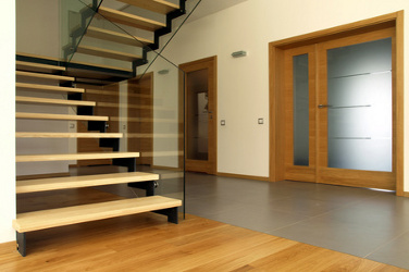 Wooden and glass stairs in the modern house interior